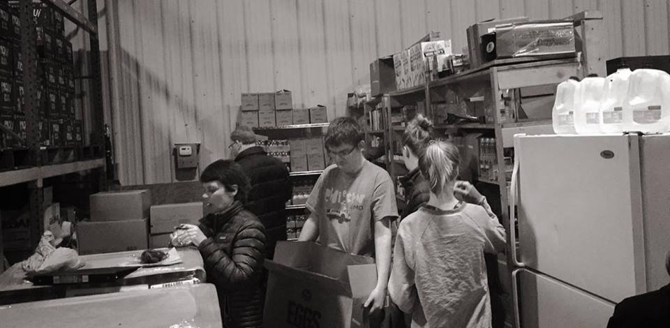 FHL Volunteers:  Cleaning the Warehouse